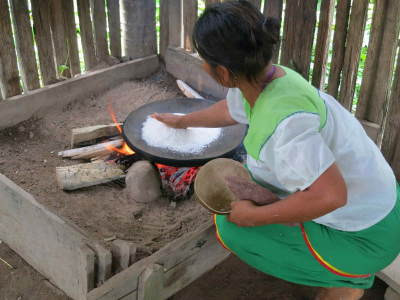 5 BEST AMAZON TOURS IN ECUADOR [TO SEE ANIMALS]: Amazon Rainforest tribal Woman prepairing manioc for visitors of the Amazon in Ecuador.