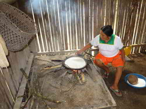 Siona woman preparing food during and Eciador Amazon Expedition visit.