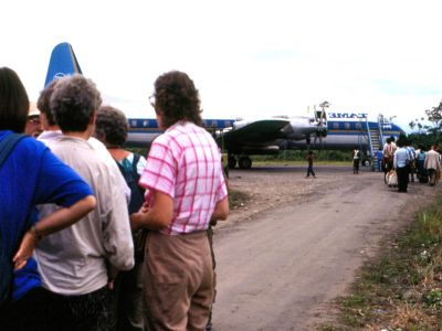 BEDREIGINGEN VAN HET AMAZONEGEBIED VAN ECUADOR: Historical picture of ecotourists for Cuyabeno flying from Lagoagrio.