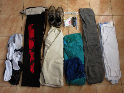 Vacation Packing List for the Tropics: Roll up clothes for compact packing.
